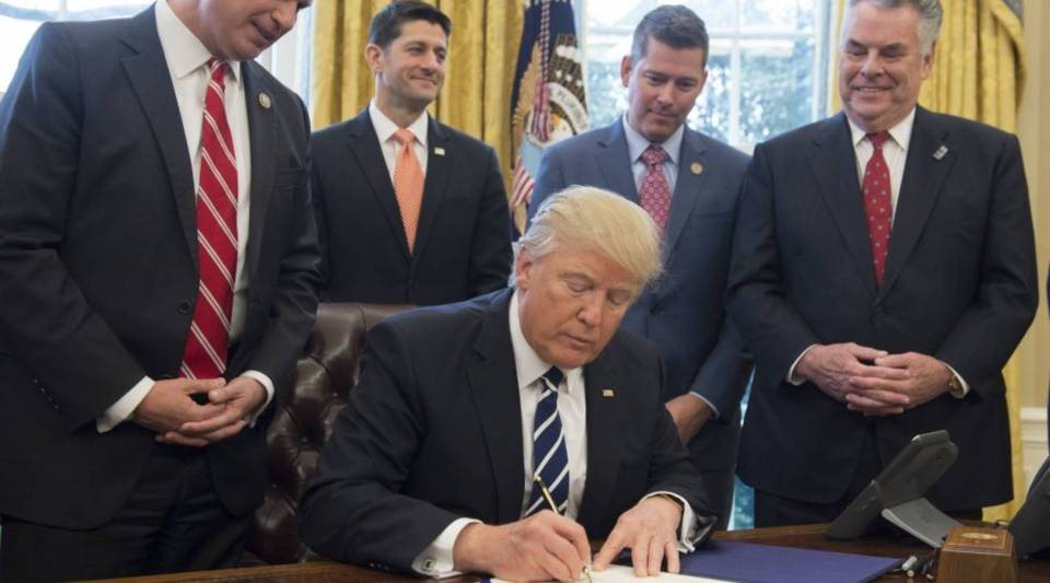 President Donald Trump signs House Joint Resolution 41, which removes some Dodd-Frank regulations on oil and gas companies.