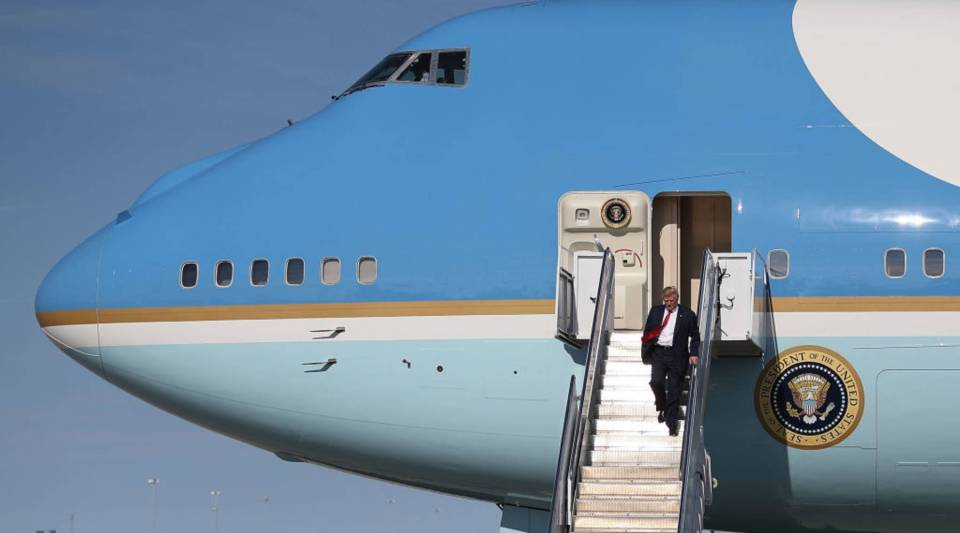President Donald Trump walks down the stairs after arriving on Air Force One at the Palm Beach International Airport to spend part of the weekend at Mar-a-Lago resort on February 17, 2017 in West Palm Beach, Florida.