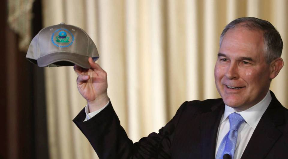 Environmental Protection Agency Administrator Scott Pruitt holds up an an agency baseball hat as he addresses employees at the agency's Washington, D.C., headquarters in February.