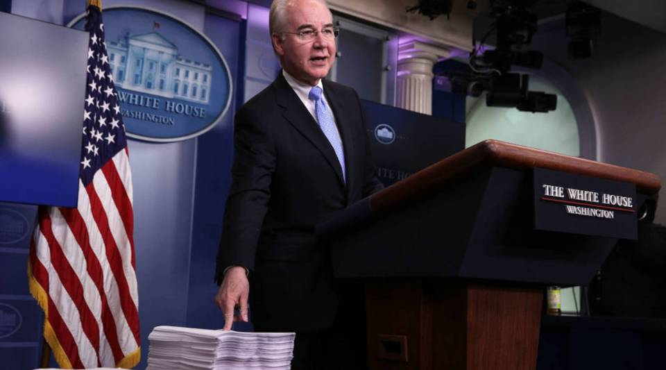 Tom Price, U.S. secretary of Health and Human Services, compares a copy of the Affordable Care Act, right, and a copy of the new House Republican health care bill at the White House daily press briefing.
