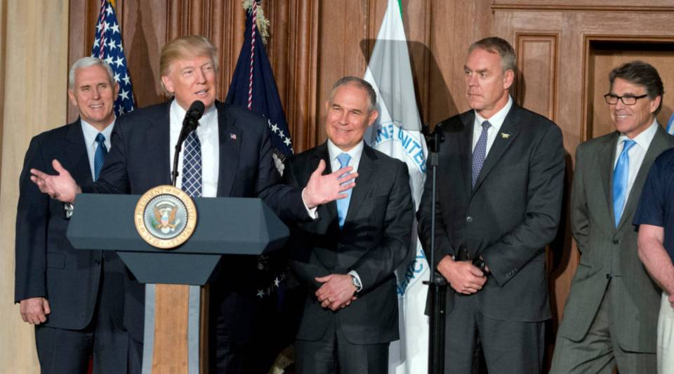 President Donald Trump signs an executive order at the Environmental Protection Agency today in Washington, D.C., that reverses the Obama-era climate change policies.