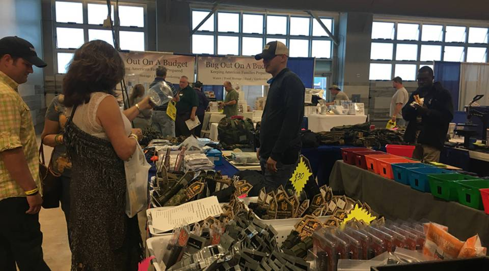 Customers check out survival gear, such as army backpacks, knives and freeze-dried food, at the National Preppers and Survivalists expo in Gonzales, Louisiana.