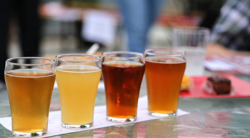 A view of several beverages from Denizens Brewing Co.