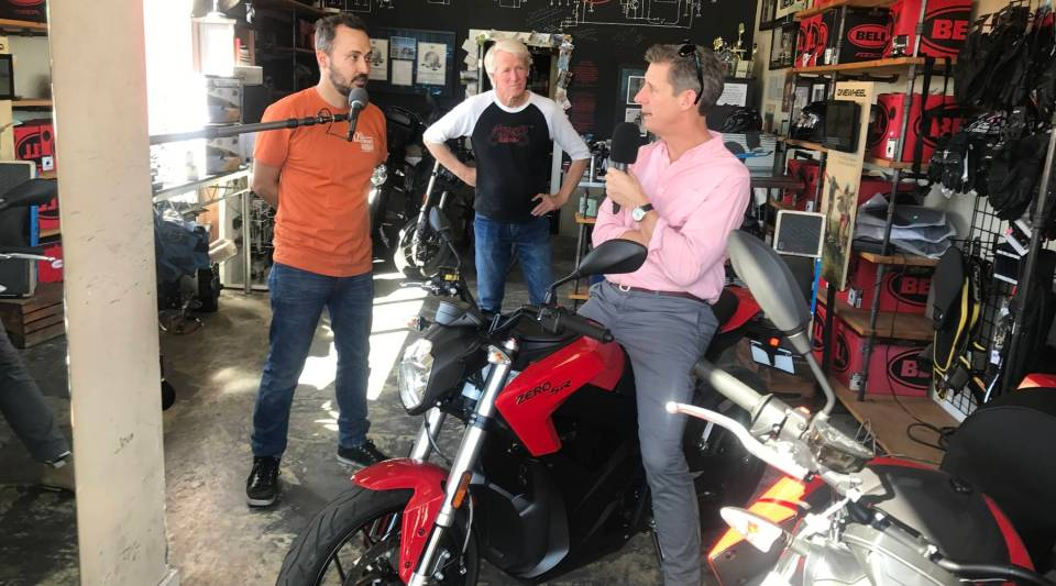 Kai Ryssdal, right, talks with Harlan Flagg, left, of Hollywood Electrics. Flagg says the store is No. 1 dealer of electric motorcycles.