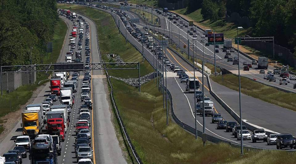 Heavy traffic moves southbound and northbound along I-95 in Quantico, Virginia.