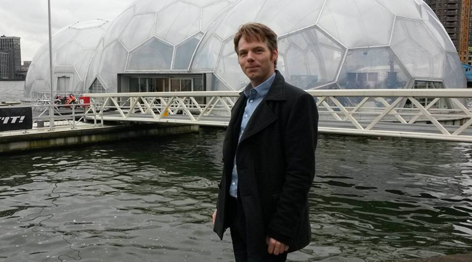 Bart Roeffen with his floating pavilion in Rotterdam harbor.