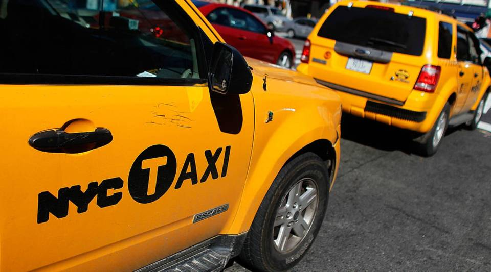New York City taxis wait for passengers.
