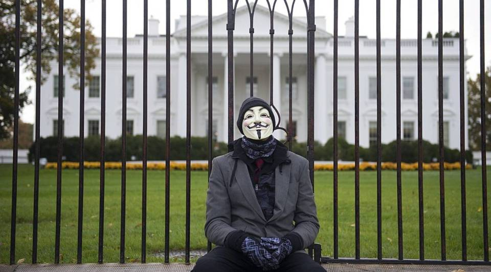 A demonstrator, and supporter of the group Anonymous, rests during a protest against corrupt governments and corporations in front of the White House in Washington, D.C.