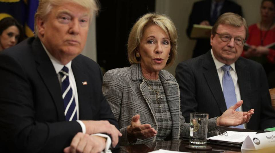 U.S. Secretary of Education Betsy DeVos speaks as President Donald Trump and educator Kenneth Smith listen during a parent-teacher conference listening session at the Roosevelt Room of the White House.
