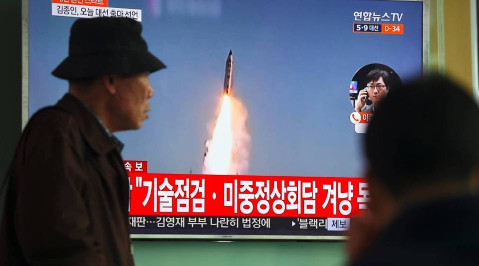 A man walks past a television screen showing file footage of a North Korean missile launch, at a railway station in Seoul on April 5, 2017. Nuclear-armed North Korea fired a ballistic missile into the Sea of Japan on April 5, just ahead of a highly-anticipated China-US summit at which Pyongyangs accelerating atomic weapons programme is set to top the agenda.