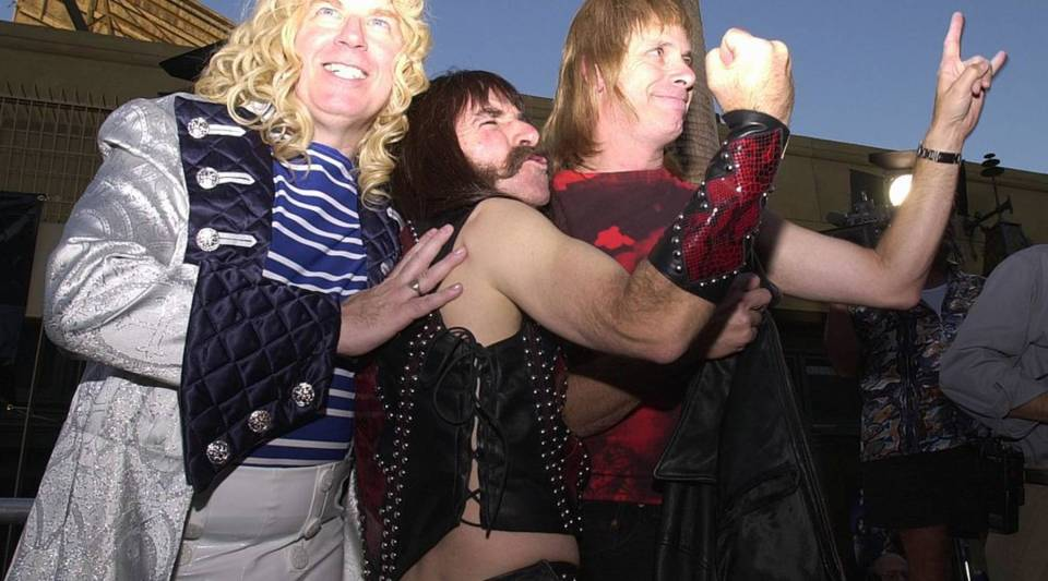 Members of Spinal Tap, from left, David St. Hubbins, Derek Smalls and Nigel Tufnel pose for photographers at a showing in 2000.