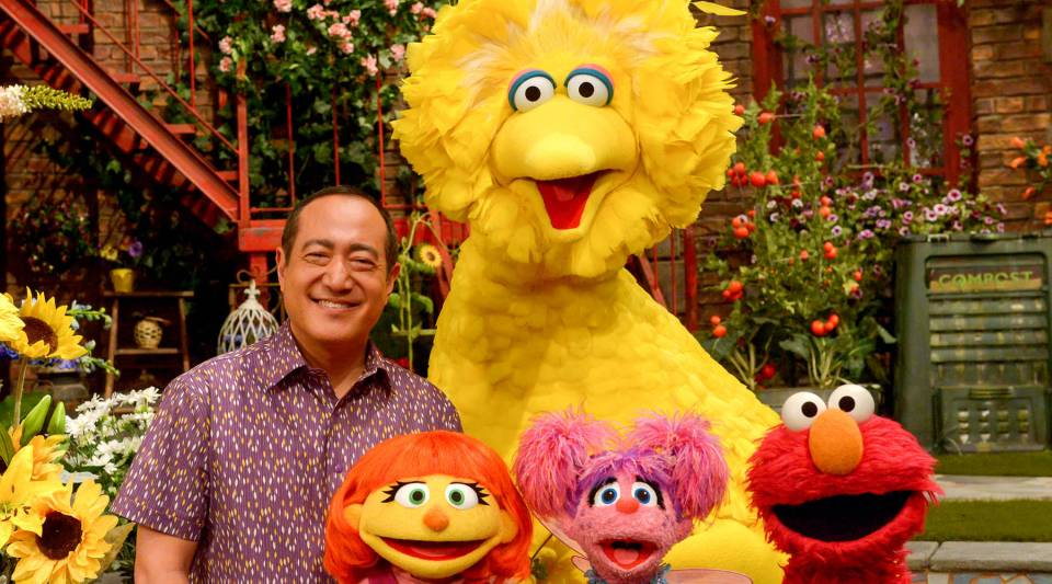 Front row, from left to right: Sesame Street characters Julia (a 4-year-old muppet with autism), Abby Cadabby and Elmo.