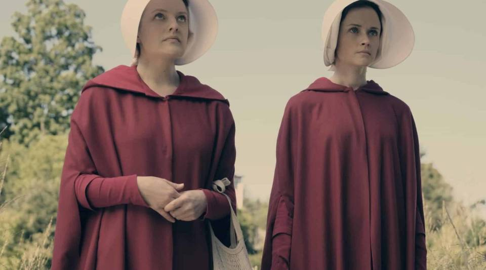 "Elisabeth Moss and Alexis Bledel in Hulu's ""The Handmaid's Tale."""