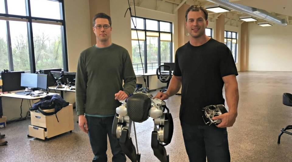 Jonathan Hurst and Mikhail Jones with Cassie the robot at Agility Robotics, in Albany, Oregon.