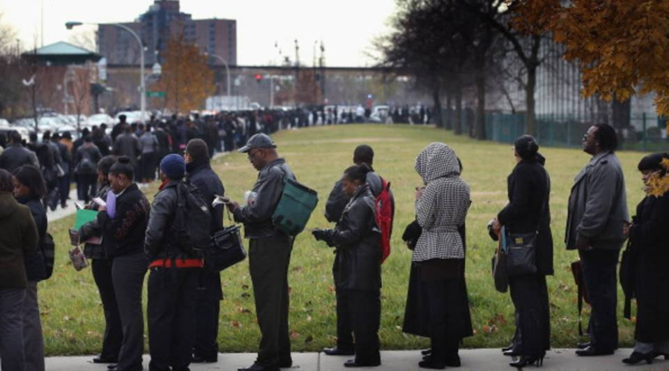 Job seekers wait in line at Kennedy-King College to attend a job fair in Chicago, Illinois.