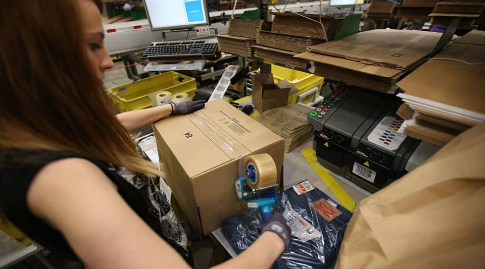 A parcel is prepared for dispatch at an Amazon warehouse.