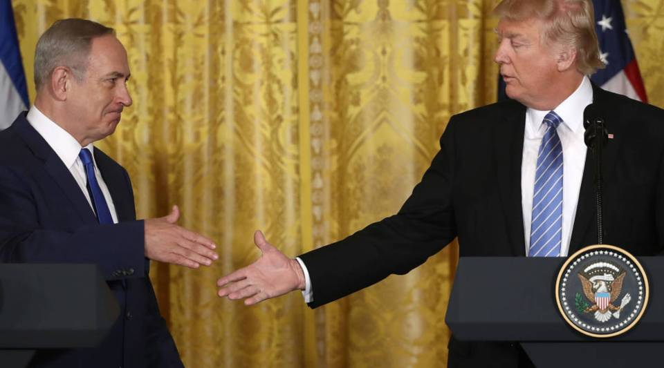 President Donald Trump and Israel Prime Minister Benjamin Netanyahu shake hands following a joint news conference at the White House in February.