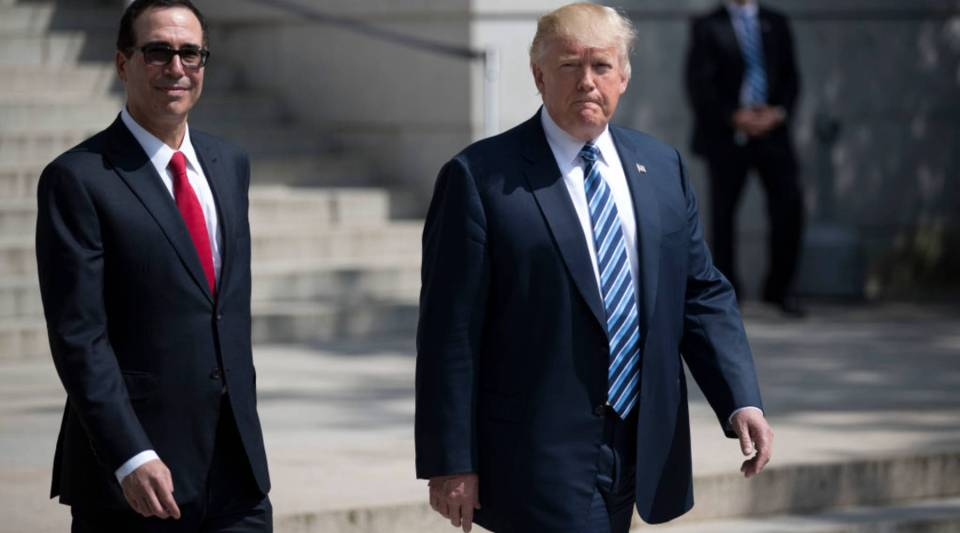 President Donald J. Trump and Secretary of Treasury Steven Mnuchin walk out of the Treasury Department after a financial services Executive Order signing ceremony on April 21, 2017 in Washington, DC.