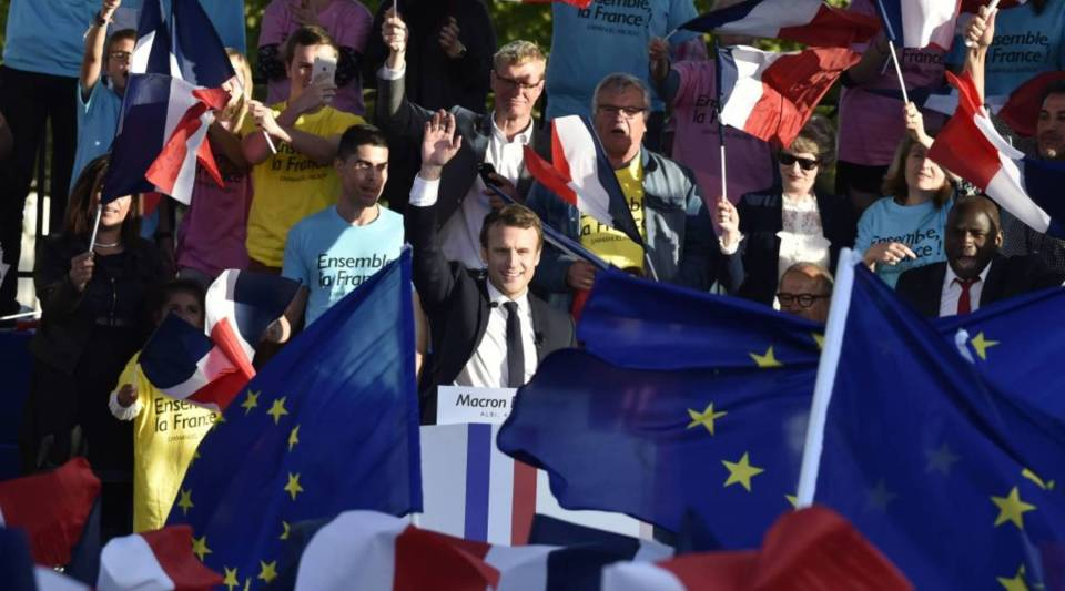 Emmanuel Macron, center, the French presidential candidate for the On the Move party, waves during a campaign rally in Albi, France, on Thursday.