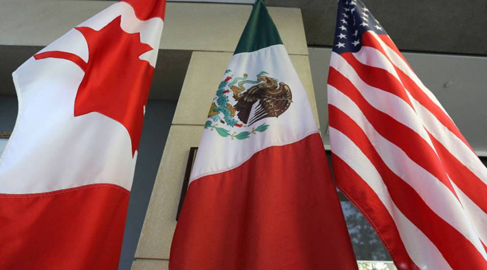 The Mexican, US and the Canadian flags sit in the lobby where the third round of the NAFTA renegotiations are taking place in Ottawa, Ontario, September 24, 2017.