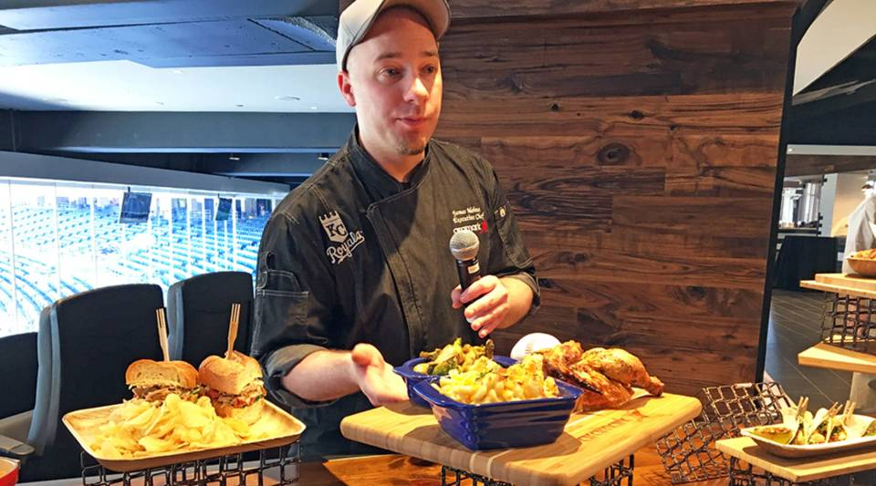 Aramark executive chef James Mehne shows off some of Kauffman Stadium's new food items, including truffled mac and cheese, lemon garlic rotisserie chicken and roasted Brussels sprouts.