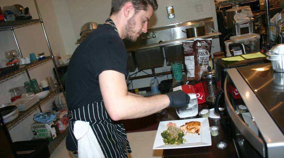 Working in Tovala's test kitchen, chef Alexander Plotkin plates one of the company's meals.