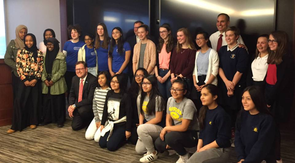 U.S. Bank Chief Innovation Officer Dominic Venturo and Chief Executive Andy Cecere pose with teenage girls the bank sponsored as part of Technovation, a global app-building competition.