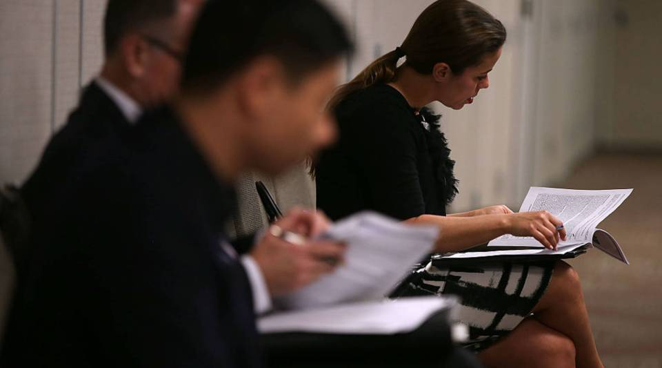 Job seekers apply for open positions at a career fair in San Francisco.