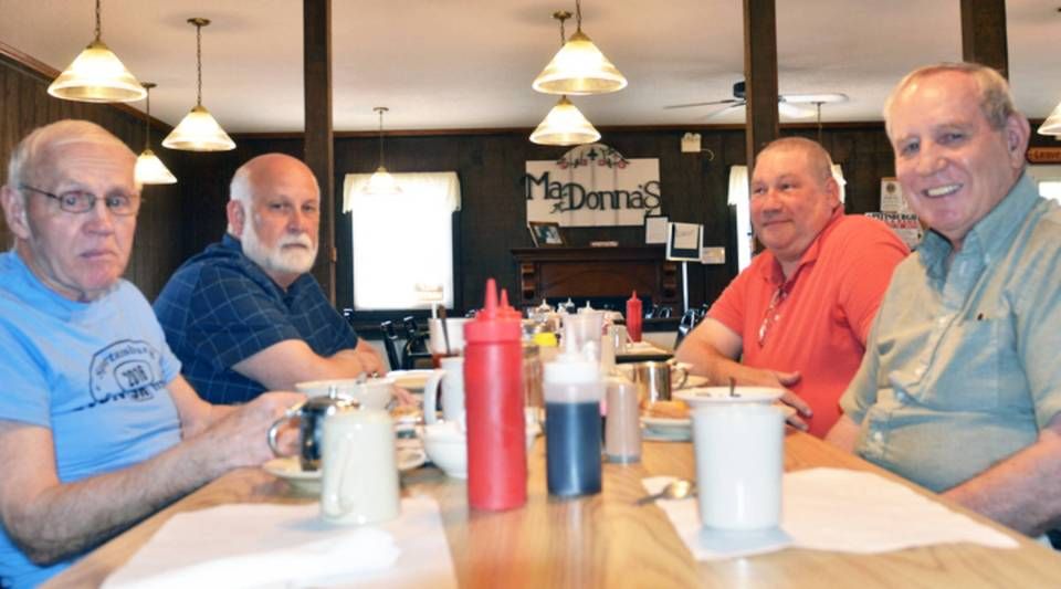 At Ma-Donna's Restaurant, a local gathering spot in Erie County's Union City, Marketplace host Kai Ryssdal checked in to see how locals feel about President Trump's first 100 days. From left to right: Merv Troyer, Robert Glen, Keith Troyer, and Norm Troyer.