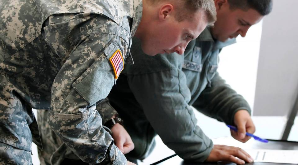 Veterans register for a job fair.