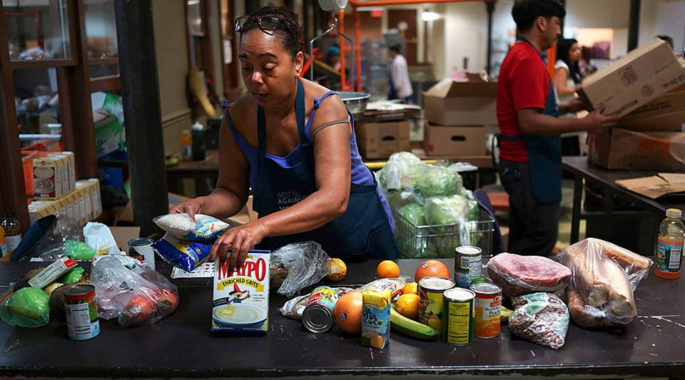 Volunteers sort food at the West Side Campaign Against Hunger food pantry in New York City.