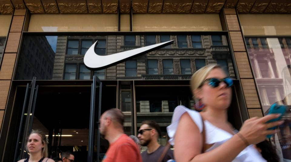 Shoppers exit the Nike SoHo store in New York City.