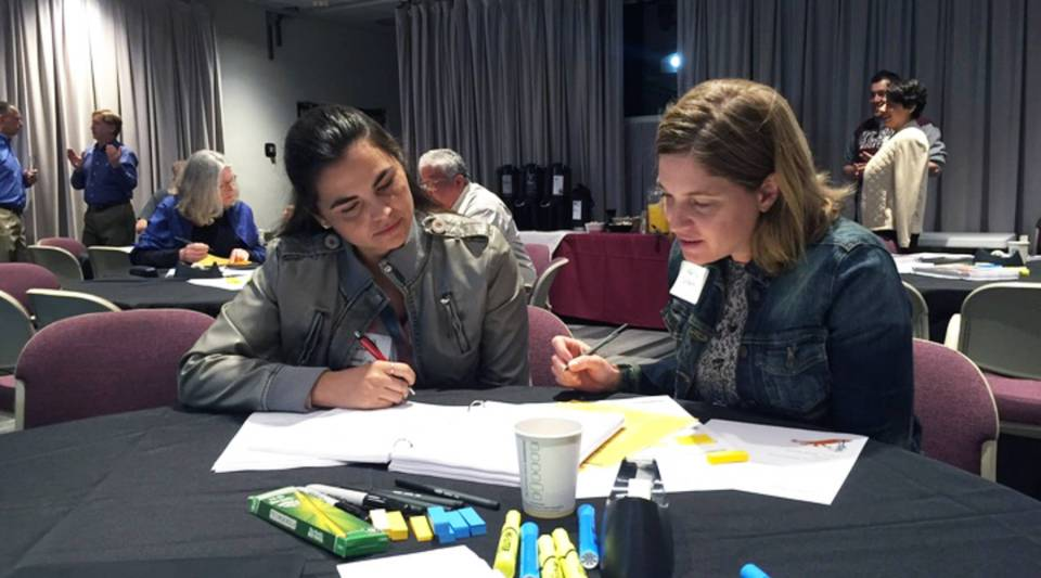 Alana Bachor, left, and Kelly Coreas create a semester-by-semester plan for a student studying respiratory therapy.
