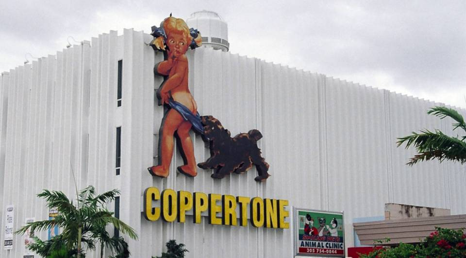 The Coppertone logo on a building in Miami.