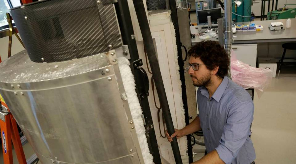 Aaron Palumbo looks into a furnace he helped develop in a lab on the University of Colorado campus in Boulder. His company, Big Blue Technologies, received a $3.6 million ARPA-E grant in 2014.