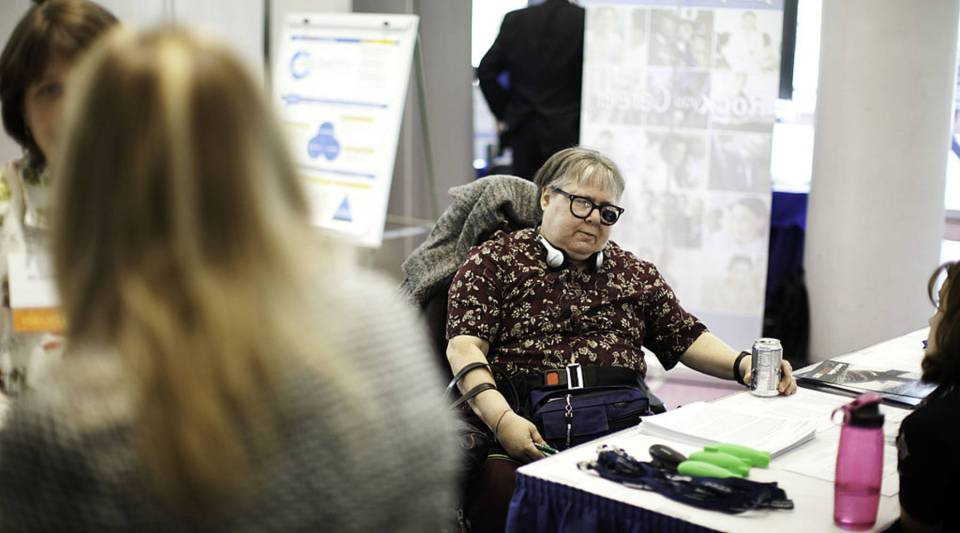 Linda Wright (C), 57, attends a job conference for unemployed people with disabilities at Manchester Community College in Manchester, Connecticut.