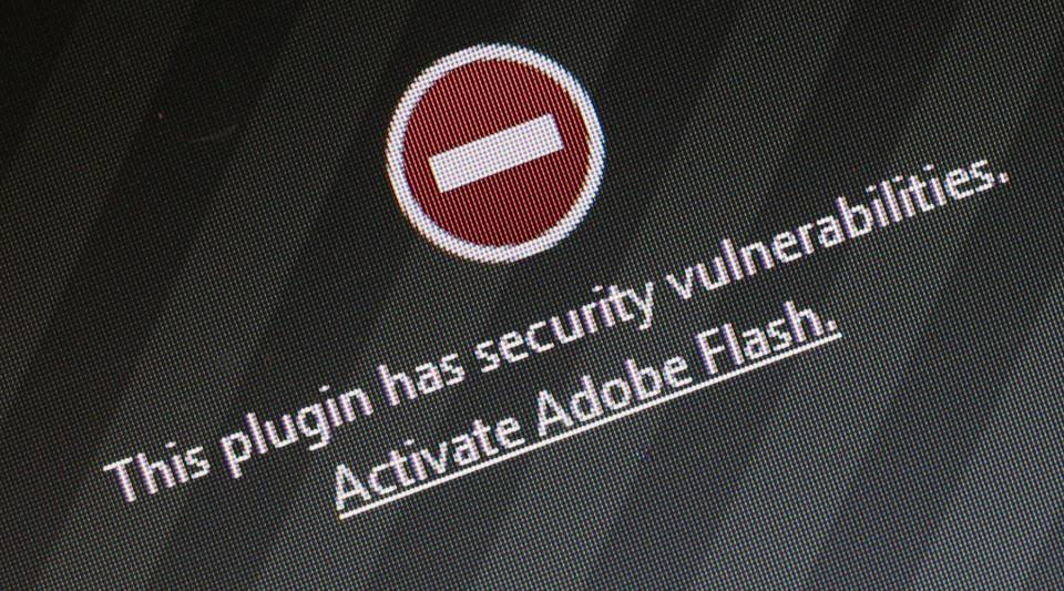 A window on the Mozilla Firefox browser shows the browser has blocked the Adobe Flash plugin.
