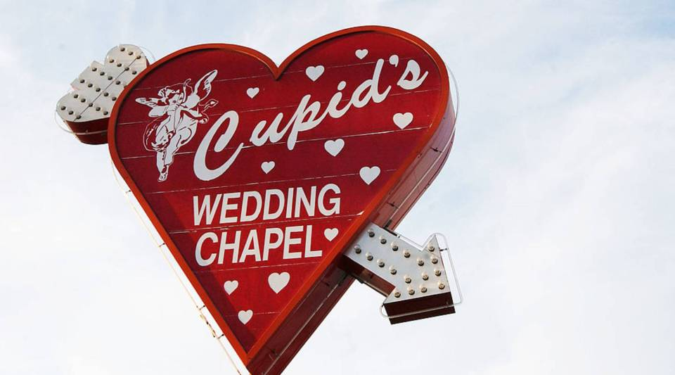 Cupid's Wedding Chapel sign is seen on display in Las Vegas, Nevada.
