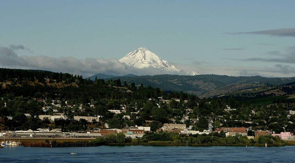 Mt. Hood rises in the background as the town of The Dalles is seen on the Columbia River June 15, 2006 in Oregon.