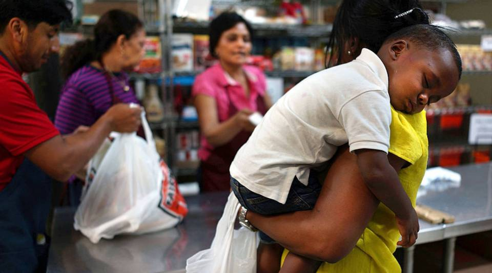 A mother and her child at the West Side Campaign Against Hunger food bank in New York City.