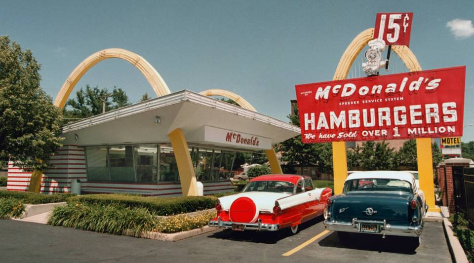 A 1955 Ford, left, and a 1955 Oldsmobile are parked in the lot of the McDonald's museum in Des Plaines, IL.