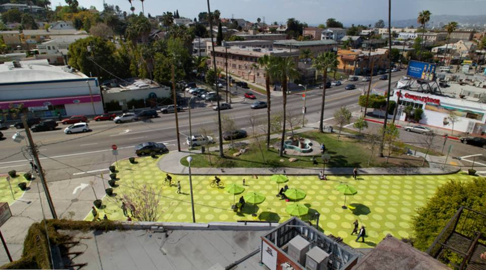 Sunset Triangle Plaza in Los Angeles, CA is pedestrianized and uses planters as barriers between people and busy Sunset Boulevard.