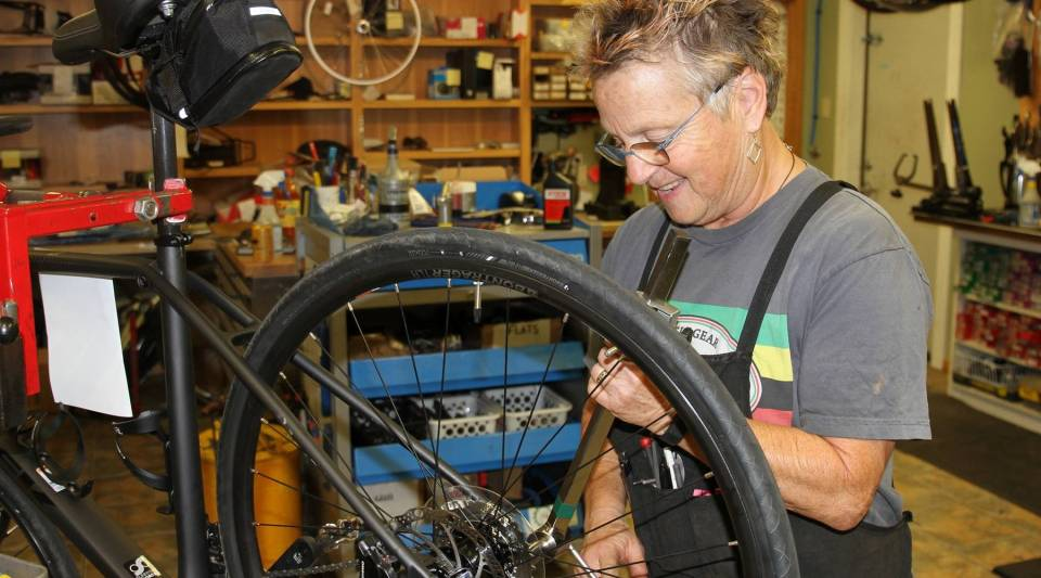 Bike mechanic Barb Bohm-Becker hopes Oregon's $15 sales tax will diffuse claims that cyclists don't pay their share for infrastructure.