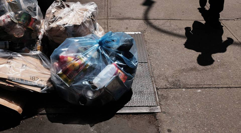 One idea to get more people recycling in New York is to give them bags with a bar code on it that would attribute the load to a particular apartment. Above, bags of recycling are piled on a Manhattan street.