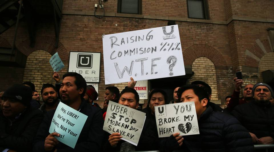 Uber drivers protest company fare cuts in New York City in February 2016.