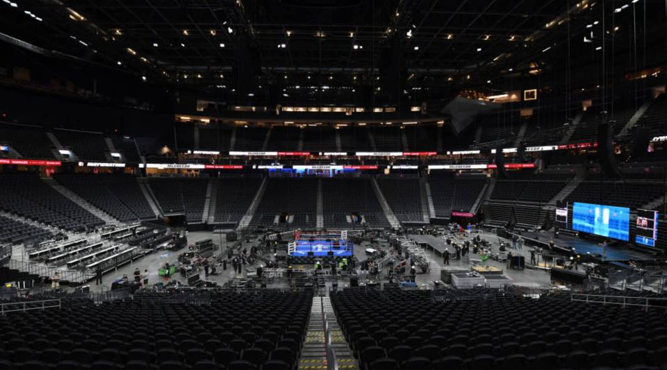 Workers set up at T-Mobile Arena ahead of the weigh-in and bout between boxer Floyd Mayweather Jr. and UFC lightweight champion Conor McGregor on August 24, 2017 in Las Vegas, Nevada. The fighters will meet in a super welterweight boxing match at the arena on August 26.