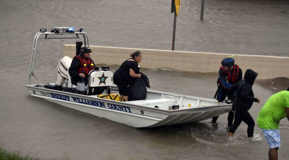 A Sheriff's boat rescues people after Hurricane Harvey caused heavy flooding in Houston, Texas on August 28, 2017.
