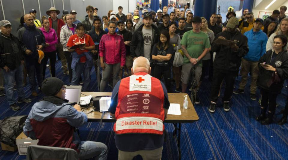 Volunteers get a briefing on Monday at the George R. Brown Convention Center in Houston, where the American Red Cross is housing victims of Hurricane Harvey.