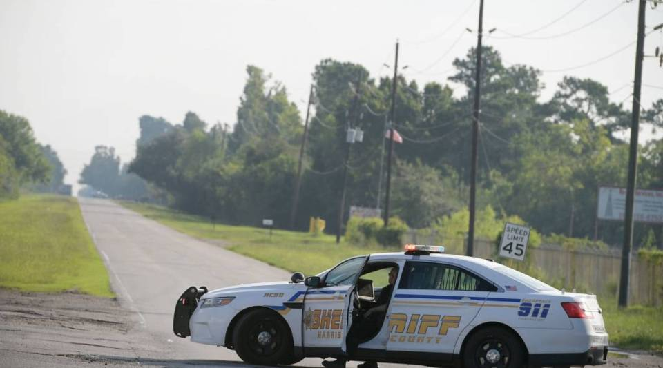 A Harris County Sheriff vehicle blocks access on the Crosby Dayton Road which leads towards the Arkema Chemical Plant in Crosby, Texas on August 31, 2017.