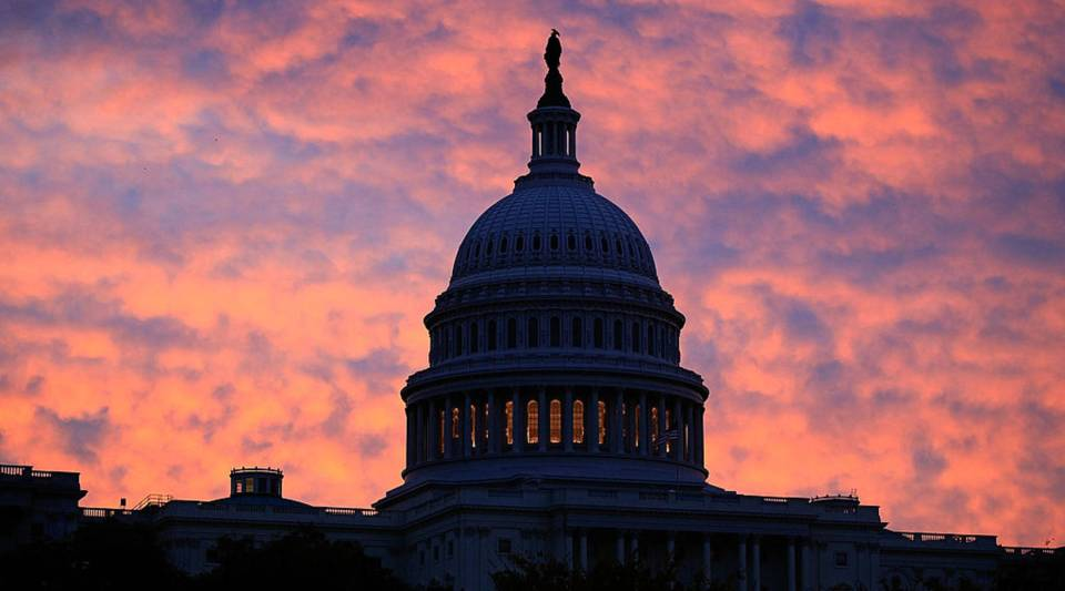 The early morning sun rises behind the US Capitol Building on October 22, 2009 in Washington, DC.